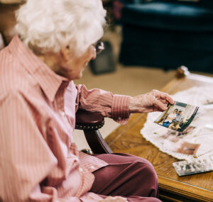 Margaret looking at an old photograph of her and her late husband